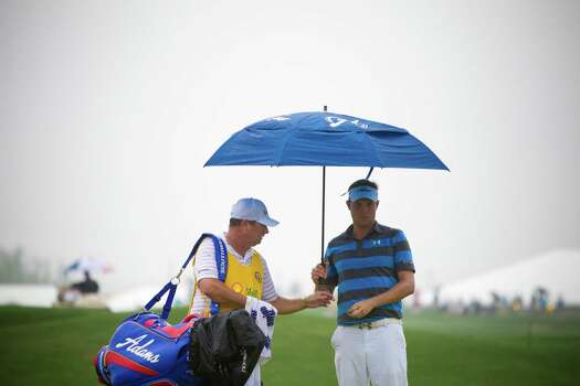 Jeff Overton studies the 1st hole on the green under the rain during the Shell Houston Open, Thursday, April 3, 2014, in Humble. Photo: Marie D. De Jesus, Houston Chronicle / © 2014 Houston Chronicle