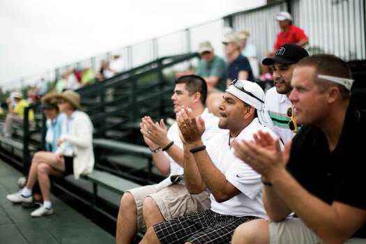 Mario Chapa, left, Ricky Hernandez, center and Marcus Henneke enjoy the first round of the Shell Houston Open, Thursday, April 3, 2014, in Humble. Photo: Marie D. De Jesus, Houston Chronicle / © 2014 Houston Chronicle
