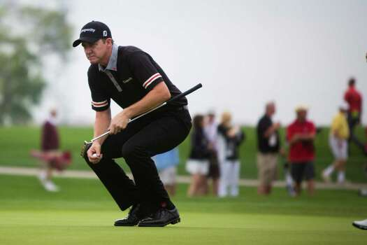 Jimmy Walker studies the first hole from the green of the Golf Club of Houston during the Shell Houston Open, Thursday, April 3, 2014, in Humble. Photo: Marie D. De Jesus, Houston Chronicle / © 2014 Houston Chronicle