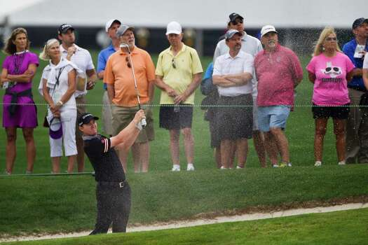 Jimmy Walker swings a bunker shot at the first hole of the Shell Houston Open first round, Thursday, April 3, 2014, in Humble. Photo: Marie D. De Jesus, Houston Chronicle / © 2014 Houston Chronicle