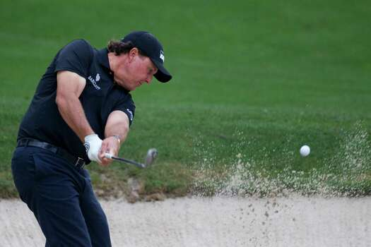 Phil Mickelson shoots from a bunker from the 13th hole during the Shell Houston Open, Thursday, April 3, 2014, in Humble. Photo: Marie D. De Jesus, Houston Chronicle / © 2014 Houston Chronicle