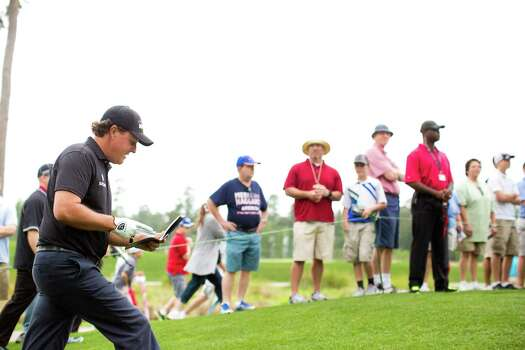 Phil Mickelson walks from the 12th hole to the 13th teeing grounds, Thursday, April 3, 2014, in Humble during the Shell Houston Open. Photo: Marie D. De Jesus, Houston Chronicle / © 2014 Houston Chronicle