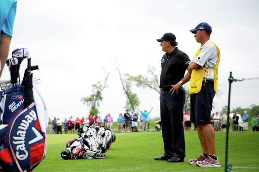 Phil Mickelson watches the play by Keegan Bradley and Webb Simpson, Thursday, April 3, 2014, during the Shell Houston Open first round in Humble. Photo: Marie D. De Jesus, Houston Chronicle / © 2014 Houston Chronicle