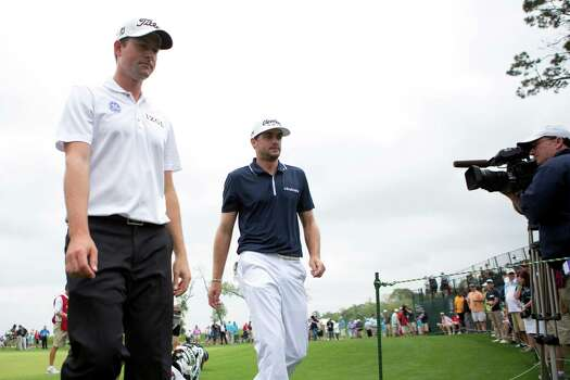 Keegan Bradley, right, and Webb Simpson walk out of the first hole green, Thursday, April 3, 2014, during the Shell Houston Open first round, in Humble. Photo: Marie D. De Jesus, Houston Chronicle / © 2014 Houston Chronicle