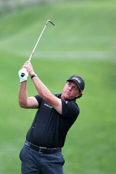 Phil Mickelson shoots from the fairway during the Shell Houston Open first round, Thursday, April 3, 2014, in Humble. Photo: Marie D. De Jesus, Houston Chronicle / © 2014 Houston Chronicle