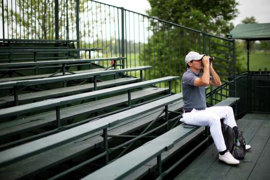 A golf fan watches the Shell Houston Open event from the first hole stands, Thursday, April 3, 2014, in Humble. Photo: Marie D. De Jesus, Houston Chronicle / © 2014 Houston Chronicle
