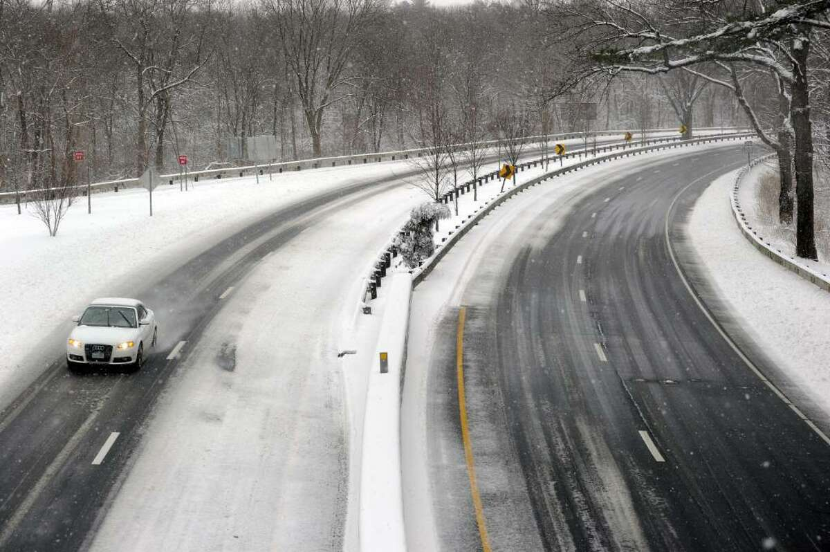 Traffic is sparse along the Merritt Parkway as snow falls faster than the plow trucks can keep up with during the blizzard which closed schools and sent state and many local business workers home early Wednesday, Feb 10, 2010.