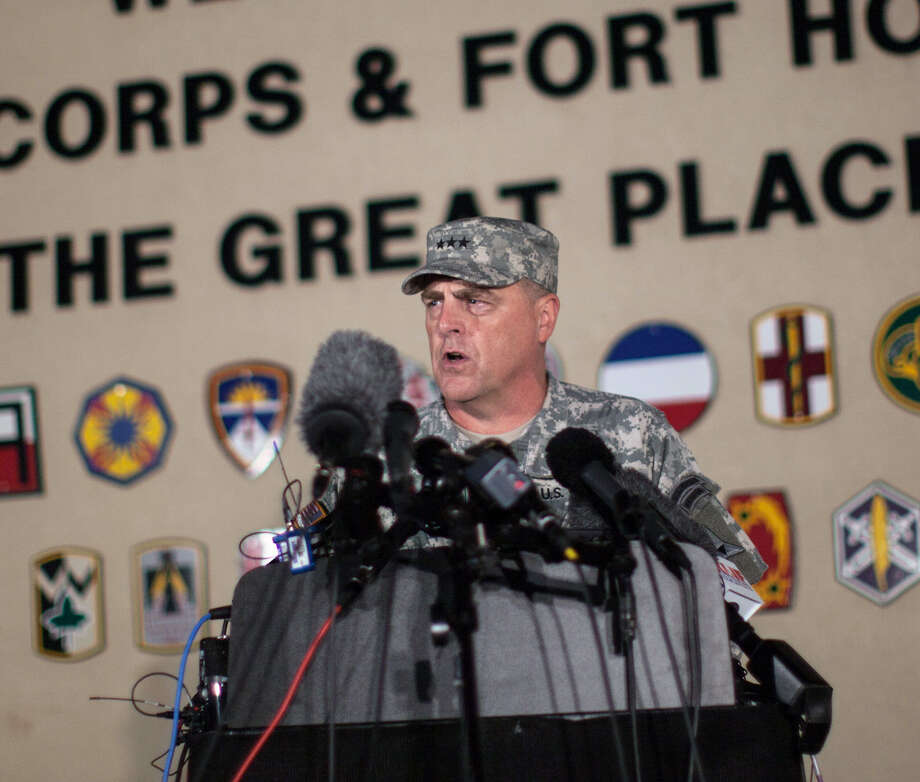 Lt. Gen. Mark Milley, commanding general of III Corps and Fort Hood, speaks with the media  after a fatal shooting  Wednesday. Photo: Tamir Kalifa / Associated Press / FR170773 AP