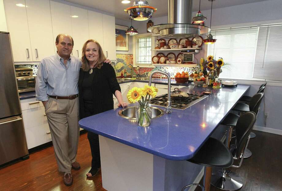 Eric Lane and wife Kellen McIntyre transformed their Monticello Park kitchen into a spacious area to cook and to socialize. They wanted a practical yet eclectic setting that was also inviting. Photo: Photos By Kin Man Hui / San Antonio Express-News / ©2014 San Antonio Express-News