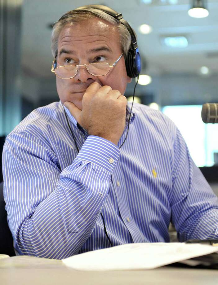Former Connecticut Gov. John Rowland fills in as a talk show host on WTIC AM radio in Farmington, Conn., Friday, July 2, 2010. (AP Photo/Jessica Hill) Photo: Jessica Hill, ST / AP2010
