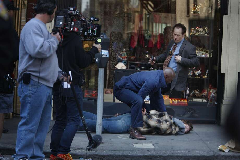 Taye Diggs (center, blue jacket) plays a cop in a scene with Raphael Sbarge (top right) and Nick Gehlfuss (bottom right). Photo: Lea Suzuki, The Chronicle