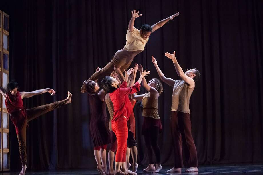 "Kelly Del Rosario soars with the help of his dancer peers in the Margaret Jenkins Dance Company's ""Times Bones."" Photo: Margo Moritz, Magaret Jenkins Dance Co."