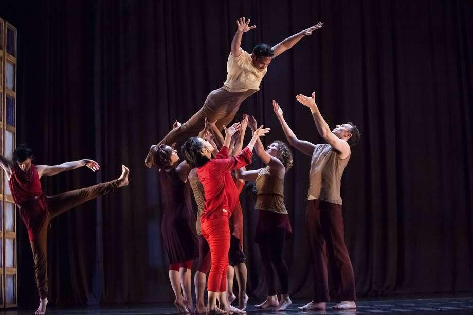 "Kelly Del Rosario soars with the help of his dancer peers in the Margaret Jenkins Dance Company's ""Times Bones."" Photo: Margo Moritz, Magaret Jenkins Dance Co."
