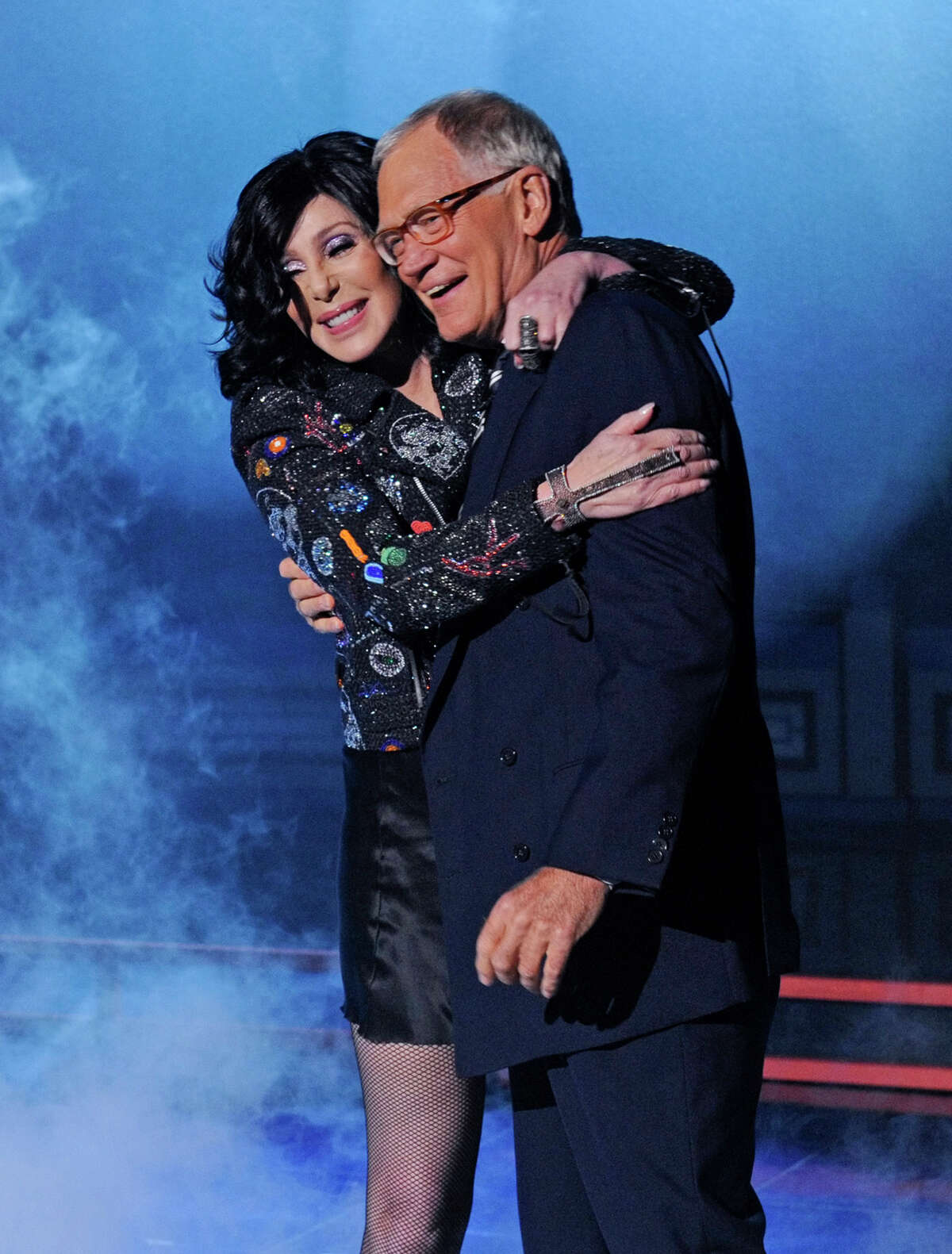 FILE - In this Sept. 24, 2013 file photo provided by CBS, Cher embraces host David Letterman after she performed a song off her new album, on