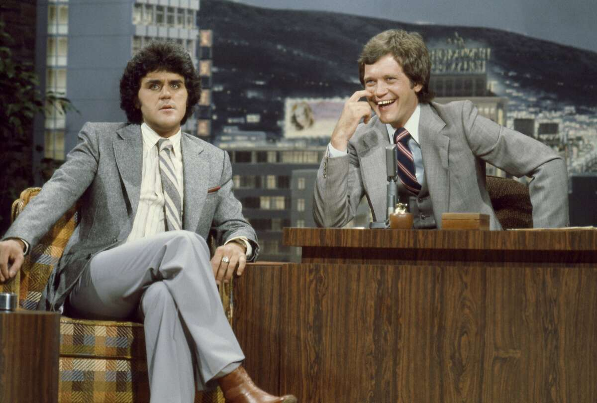 THE TONIGHT SHOW STARRING JOHNNY CARSON -- Air Date 07/04/1979 -- Pictured: (l-r) Comedian Jay Leno during an interview with guest host David Letterman on July 4, 1979 (Photo by Paul Drinkwater/NBC/NBCU Photo Bank via Getty Images)