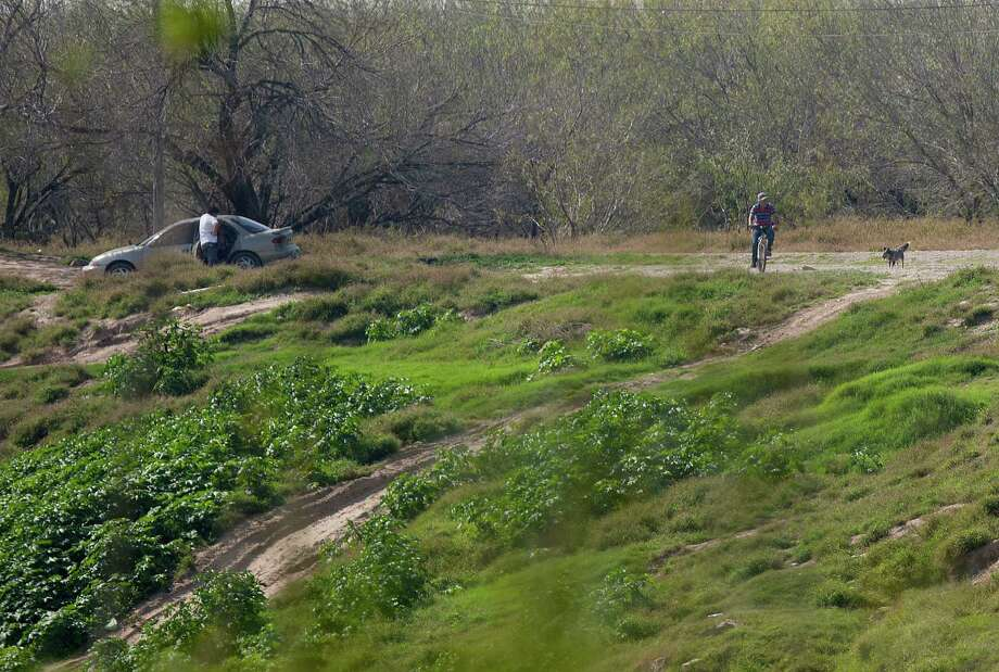 "In Mexico, across the Rio Grande from Anzaldulas Park, Hidalgo County Precinct 3 Constable Lazaro Gallardo, Jr., said lookouts will often give smugglers the ""all-clear"" before sending people illegally into the U.S. Thursday, Feb. 20, 2014, in Mission. Anzaldulas Park is on the frontline of what federal officials have dubbed é¢Ã©""éºthe surgeé¢Ã©""é¹ é¢Ã©""é a steep increase in the numbers of children caught crossing the border illegally and alone. Arrests have spiked from 8,000 in 2008 to more than 38,000 last year. ( Johnny Hanson / Houston Chronicle ) Photo: Johnny Hanson, Staff / © 2014  Houston Chronicle"