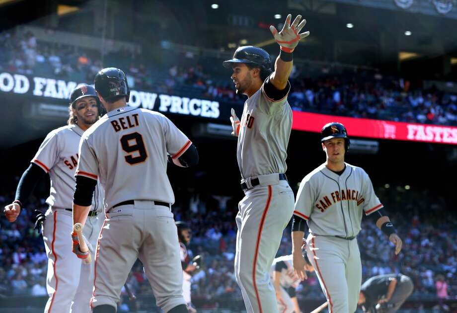 San Francisco Giants batter Angel Pagan (second from right) is congratulated by teammates after hitting a three run home run in the eighth inning against the Arizona Diamondbacks at Chase Field. Photo: Mark J. Rebilas, Reuters