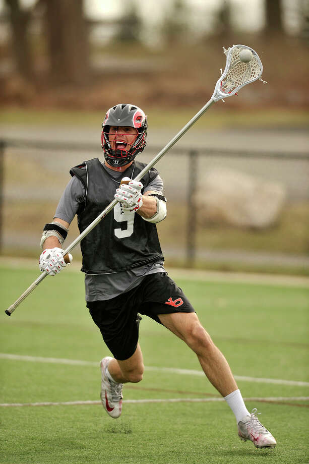 New Canaan co-captain Seth Neelman runs drills during lacrosse practice at New Canaan High School in New Canaan, Conn., on Thursday, April 3, 2014. Photo: Jason Rearick / Stamford Advocate