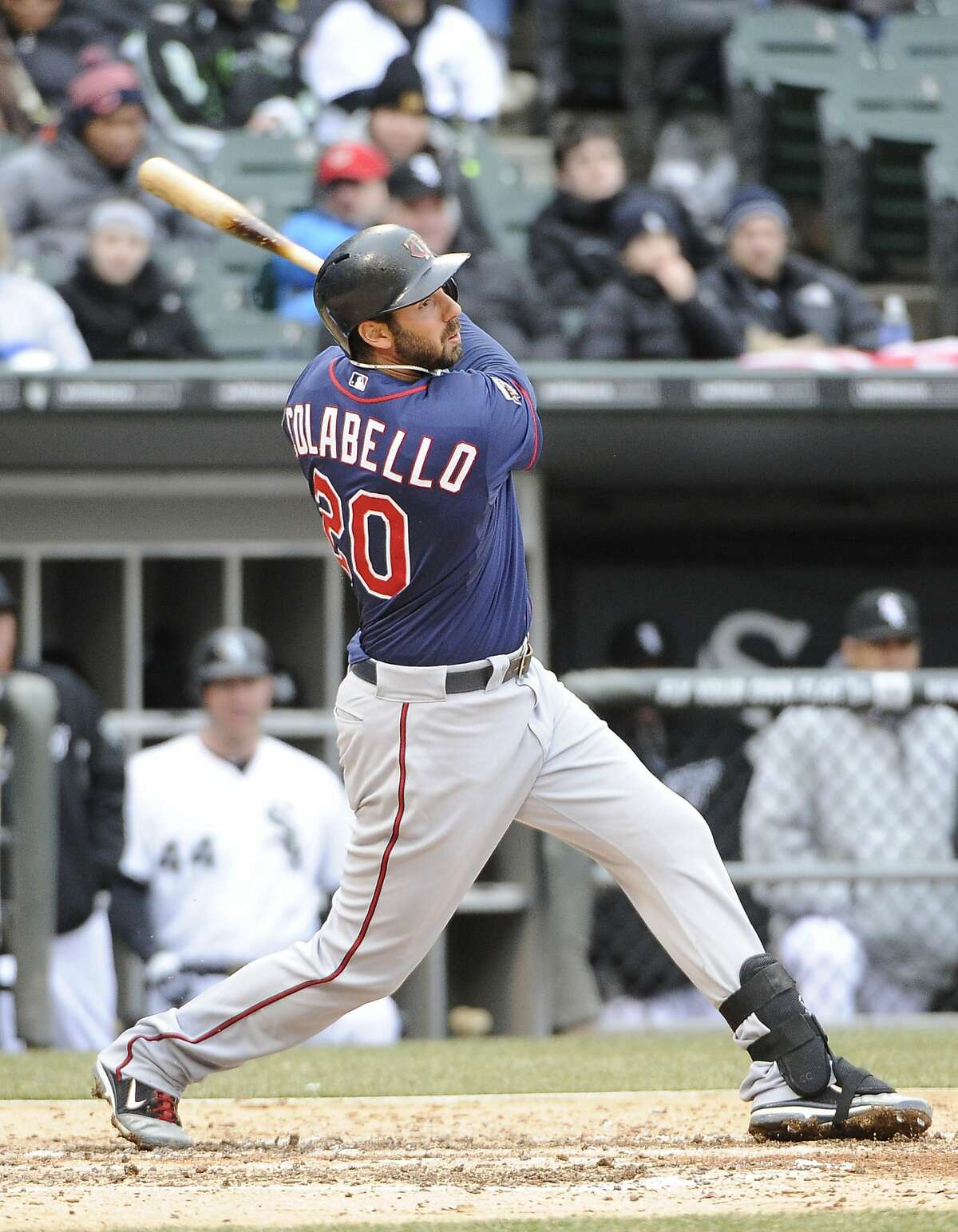Apr 3, 2014; Chicago, IL, USA; Minnesota Twins first baseman Chris Colabello (20) hits a two-EBI double against the Chicago White Sox during the third inning at U.S Cellular Field. Mandatory Credit: David Banks-USA TODAY Sports