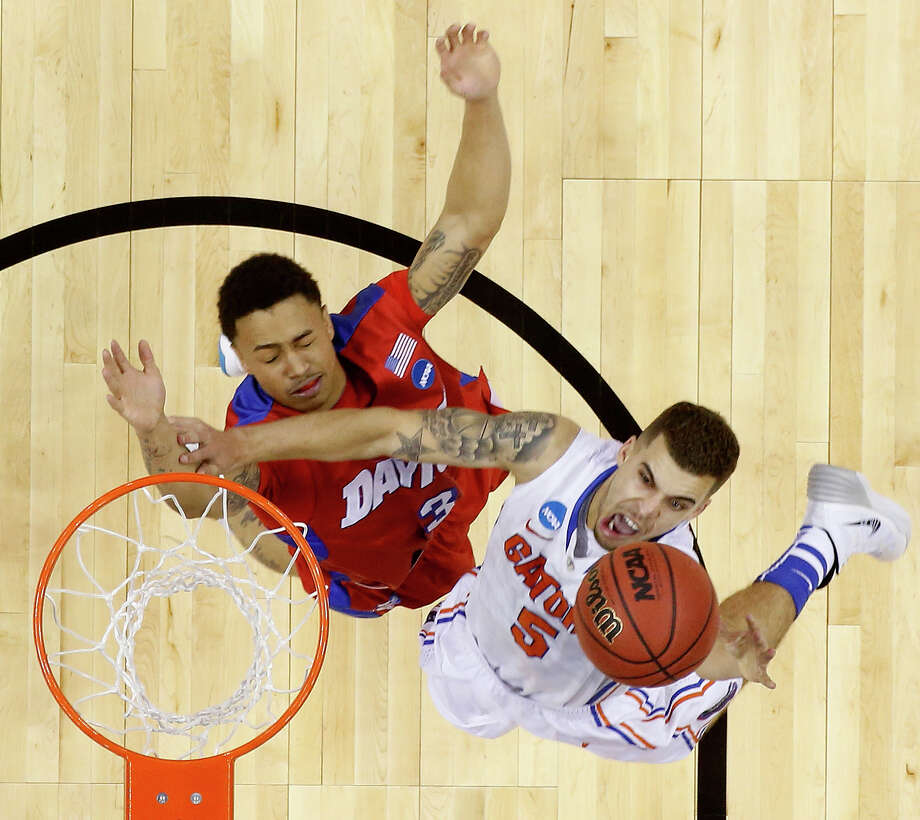 Florida guard Scottie Wilbekin (5) shoots over Dayton guard Kyle Davis (3) during the first half in a regional final game at the NCAA college basketball tournament, Saturday, March 29, 2014, in Memphis, Tenn. (AP Photo/John Bazemore) Photo: John Bazemore, Associated Press / Associated Press