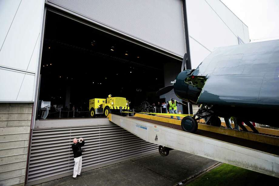 Following nearly two decades of restoration, volunteers and Museum of Flight employees worked to move a WWII-era FM-2 Wildcat fighter plane into its new permanent home Thursday, April 3, 2014, at the Museum of Flight in Seattle. Photo: JORDAN STEAD, SEATTLEPI.COM / SEATTLEPI.COM