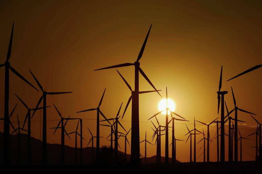 PALM SPRINGS, CA - MARCH 27:  Giant wind turbines are powered by strong winds during sunset on March 27, 2013 in Palm Springs, California. According to reports, California continues to lead the nation in green technology and has the lowest greenhouse gas emissions per capita, even with a growing economy and population.  (Photo by Kevork Djansezian/Getty Images) Photo: Kevork Djansezian, Staff / 2013 Getty Images