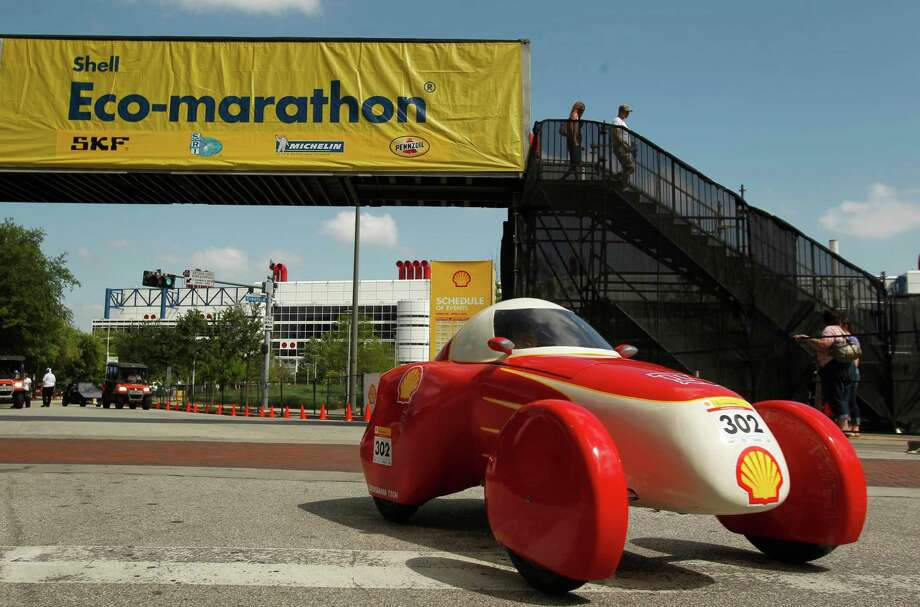 An urban concept vehicle runs the track around Discovery Green during the Shell Eco-marathon Americas in April 2012. Photo: Mayra Beltran, Staff / © 2012 Houston Chronicle
