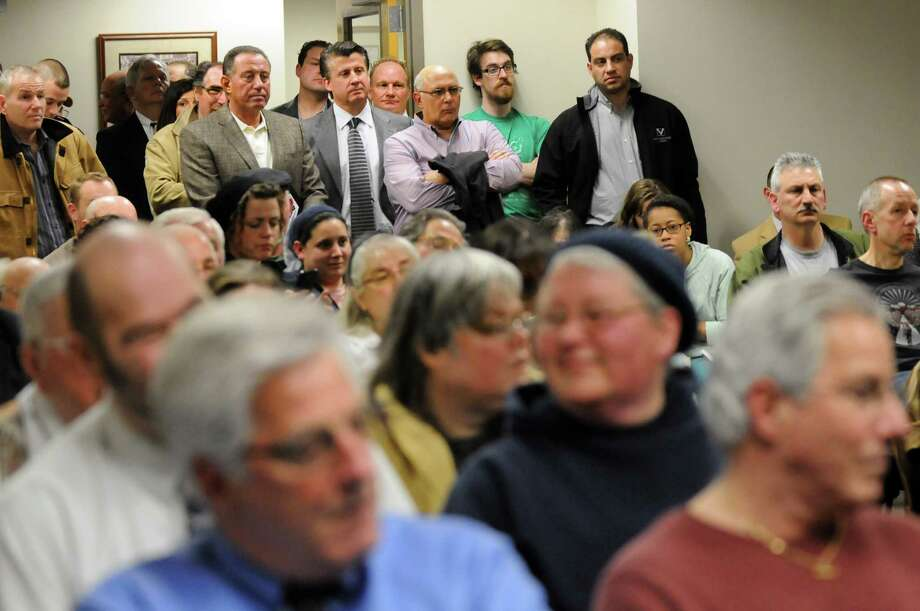The chamber is standing room only as the city council listens to impassioned opinions regarding the Scolite property on Thursday, April 3, 2014, at Troy City Hall in Troy, N.Y. (Cindy Schultz / Times Union) Photo: Cindy Schultz / 00026369A