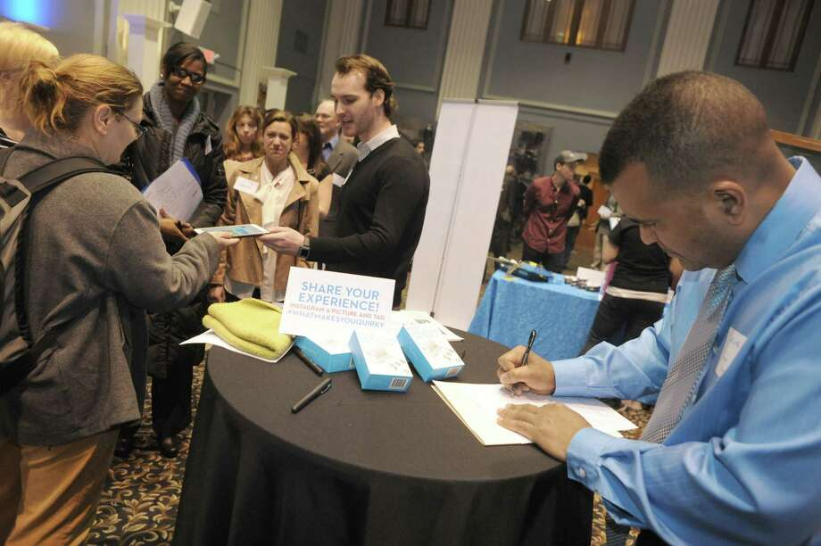Juan Davila, right, of East Greenbush fills out an application as Quirky hosted a career fair in Key Hall at Proctors Theatre on Thursday April 3, 2014 in Schenectady, N.Y. (Michael P. Farrell/Times Union) Photo: Michael P. Farrell / 00026311A