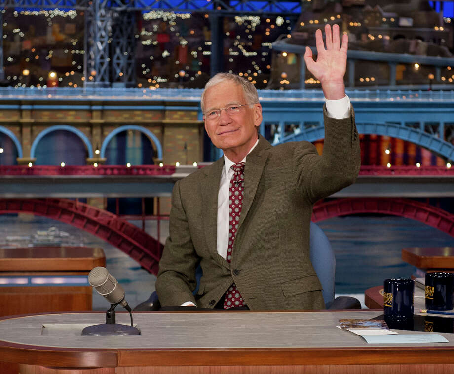 """In this photo provided by CBS, David Letterman, host of the ?Late Show with David Letterman,? waves to the audience in New York on Thursday, April 3, 2014, after announcing that he will retire sometime in 2015. Letterman, who turns 67 next week, has the longest tenure of any late-night talk show host in U.S. television history, already marking 32 years since he created """"Late Night"""" at NBC in 1982. (AP Photo/CBS, Jeffrey R. Staab) MANDATORY CREDIT, NO SALES, NO ARCHIVE, FOR NORTH AMERICAN USE ONLY Photo: Jeffrey R. Staab, HOEP / CBS"""
