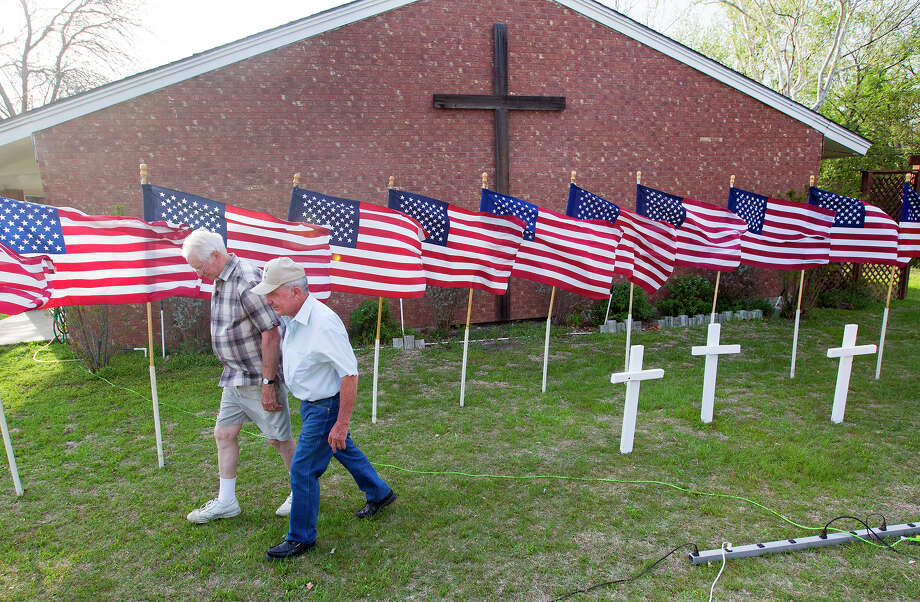 Veterans Bob Butler, left, and Bob Gordon pay tribute to the victims at the Central Christian Church in Killeen. Photo: Cody Duty, Staff / © 2014 Houston Chronicle
