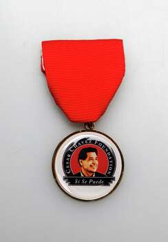 "Members of the Los Angeles-based Cesar Chavez Foundation came to San Antonio in March for a special screening of the new movie ""Cesar Chavez"" and handed out this Fiesta medal. Photo: Juanito M. Garza, San Antonio Express-News / San Antonio Express-News"