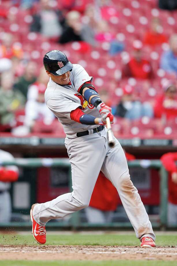 CINCINNATI, OH - APRIL 3:  Allen Craig #21 of the St. Louis Cardinals drives in a run with an infield single in the seventh inning of the game against the Cincinnati Reds at Great American Ball Park on April 3, 2014 in Cincinnati, Ohio. (Photo by Joe Robbins/Getty Images) ORG XMIT: 477579657 Photo: Joe Robbins / 2014 Getty Images
