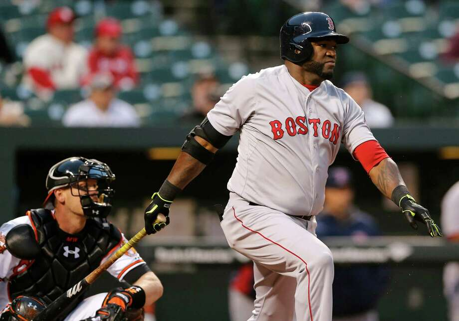 Boston Red Sox designated hitter David Ortiz, right, singles in the first inning of a baseball game against the Baltimore Orioles, Thursday, April 3, 2014, in Baltimore. (AP Photo/Patrick Semansky) ORG XMIT: MDPS112 Photo: Patrick Semansky / AP