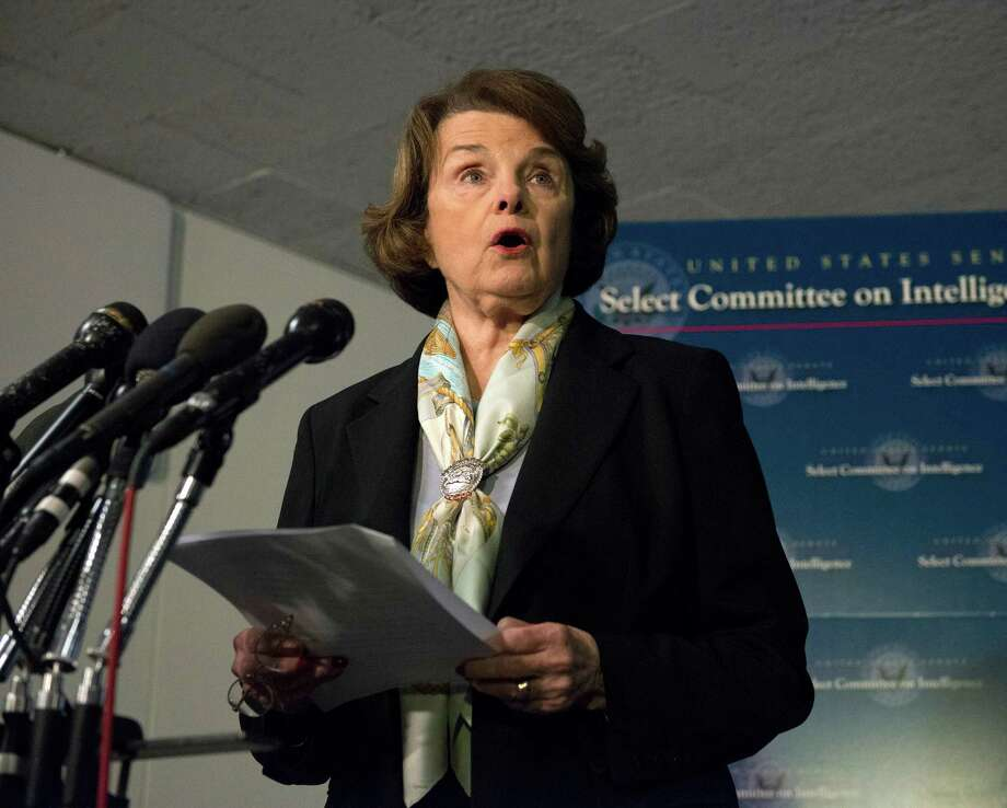 Senate Intelligence Committee Chair Sen. Dianne Feinstein, D-Calif. speaks after a closed-door meeting on Capitol Hill in Washington, Thursday, April 3, 2014, as the panel votes to approve declassifying part of a secret report on Bush-era interrogations of terrorism suspects puts the onus on the CIA and a reluctant White House to speed the release of one of the most definitive accounts about the government's actions after the 9/11 attacks. Members of the intelligence community raised concerns that the committee failed to interview top spy agency officials who had authorized or supervised the brutal interrogations.  (AP Photo/Molly Riley) ORG XMIT: DCMR105 Photo: Molly Riley / FR170882 AP
