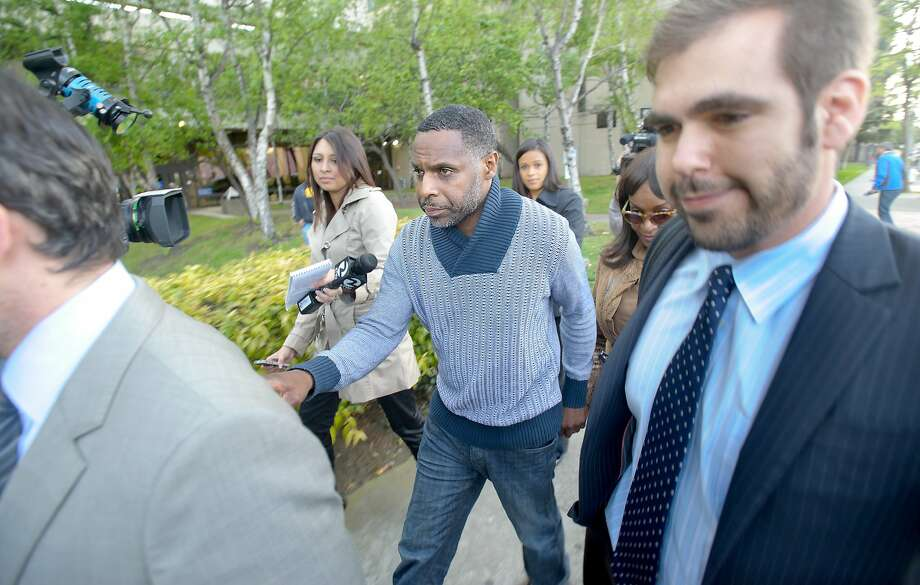 Keith Jackson (center) leaves jail in Oakland after posting bail. He faces some of the most serious charges in the case involving state Sen. Leland Yee. Photo: Noah Berger, Special To The Chronicle