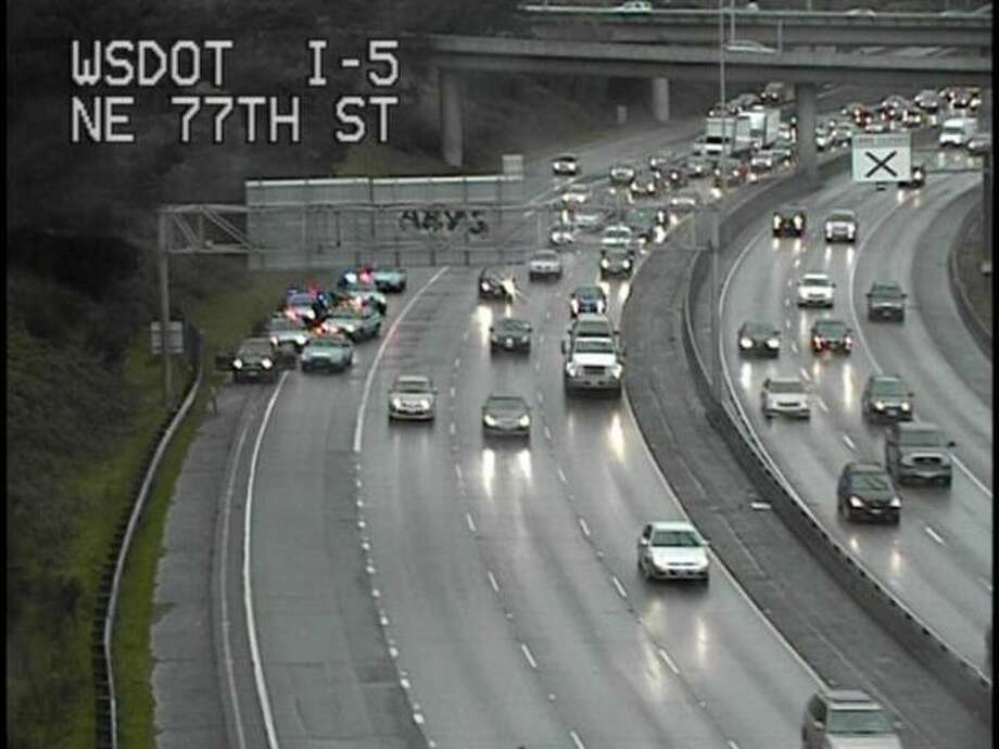 Police arrest Michael E. Montgomery on northbound Interstate 5 near the Northeast 70th Street exit in Seattle. Department of Transportation photo.