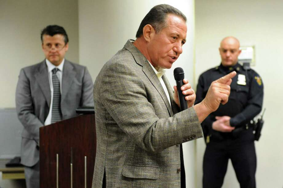 Roderick Valente of R.J. Valente Companies, center, addresses the city council about his plans for the Scolite property on Thursday, April 3, 2014, at Troy City Hall in Troy, N.Y. (Cindy Schultz / Times Union) Photo: Cindy Schultz / 00026369A