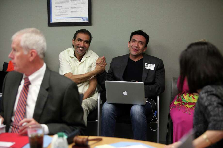 Advocates Tony Diaz, left, and Richard Reyes cheer Thursday's vote for Mexican American Studies. Photo: Mayra Beltran, Staff / © 2014 Houston Chronicle