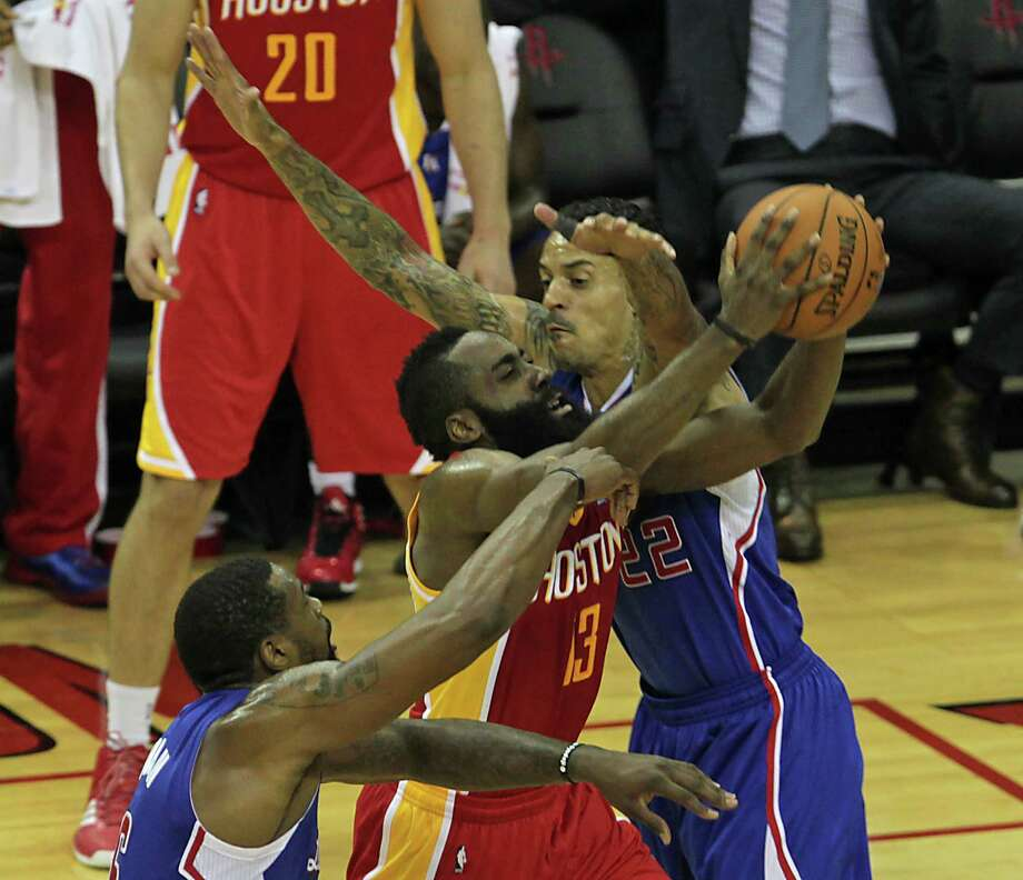 A lack of offensive movement and spacing has contributed to James Harden, center, and the Rockets being bottled up on the recent three-game losing streak. Photo: James Nielsen, Staff / © 2014  Houston Chronicle
