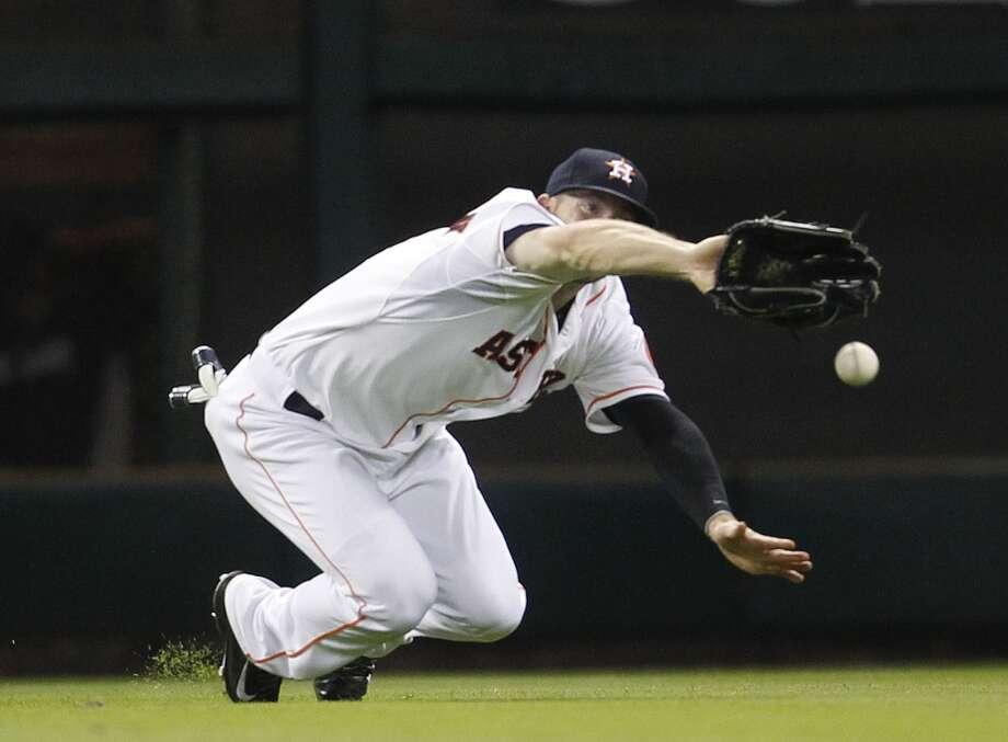 Astros left fielder Robbie Grossman reaches for a double hit by Yankee Yangervis Solarte. Photo: Karen Warren, Houston Chronicle