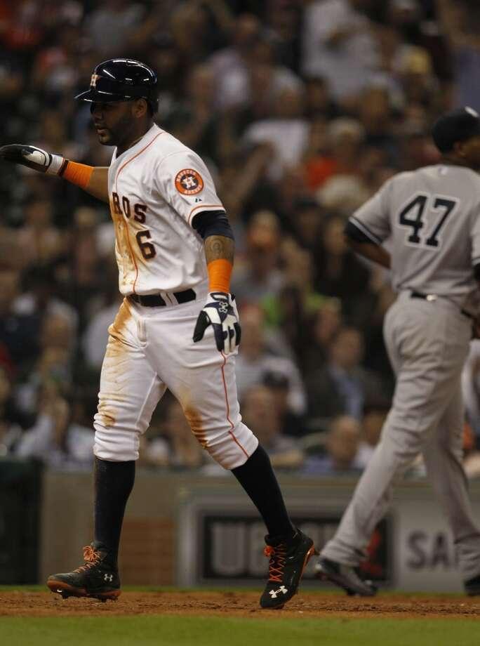 Astros shortstop Jonathan Villar celebrates his run scored on a single by Astros center fielder Dexter Fowler. Photo: Karen Warren, Houston Chronicle