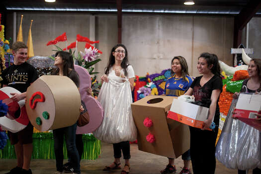Students from Marshall High School gather around their float holding costumes and props during Thursday's dress rehearsal. Photo: Julysa Sosa / Julysa Sosa For the San Antonio Express-News