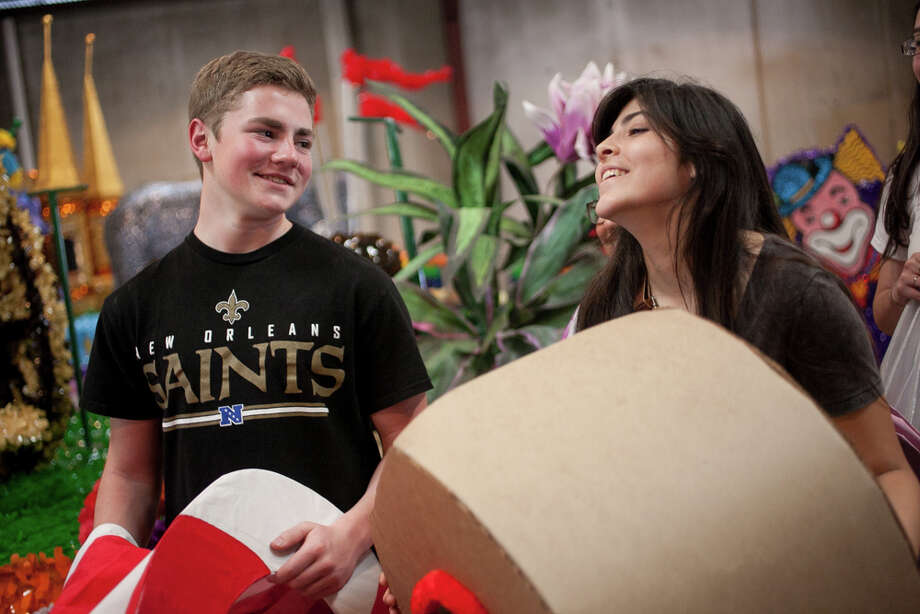 Marshall High School juniors Joel Dugas, 16, and Jessica Cantu, 17, laugh after seeing their float for the first time during Thursday's dress rehearsal. Photo: Julysa Sosa / Julysa Sosa For the San Antonio Express-News
