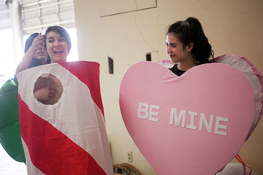 Marshall High School junior Serena Casanova (from left), 17, and freshman Sabelle Mesa, 14, wait to practice during Thursday's dress rehearsal. Photo: Julysa Sosa / Julysa Sosa For the San Antonio Express-News