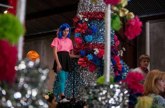 Judson High School sophomore Lilian Nino, 16, waits for directions aboard her school's float during Thursday's dress rehearsal. Photo: Julysa Sosa / Julysa Sosa For the San Antonio Express-News