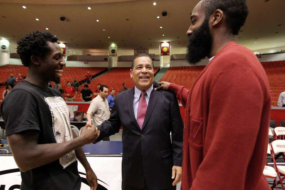 New UH coach Kelvin Sampson, center, was supported by Rockets guards Pat Beverley, left, and James Harden on Wednesday at Hofheinz Pavilion. Photo: Billy Smith II, Staff / © 2014 Houston Chronicle
