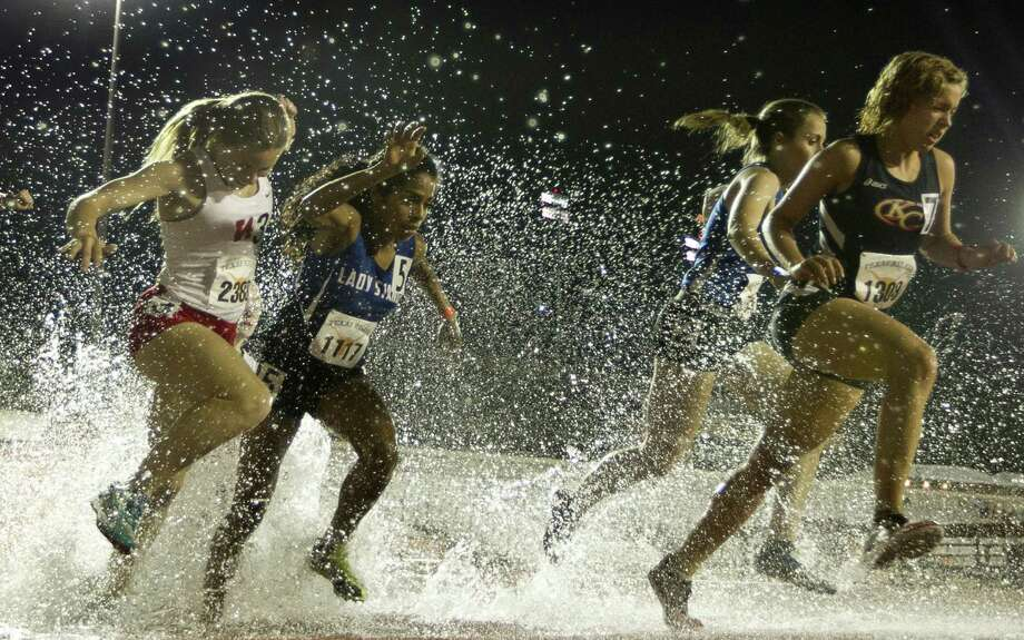 Gabby Thompson of New Braunfels (second from right) competes in the 2,000-meter steeplechase at the Texas Relays at Myers Stadium in Austin on March 27. Photo: Jay Janner / Associated Press / Austin American-Statesman
