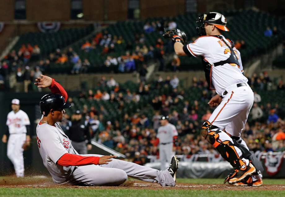 Shortstop Xander Bogaerts scores past Orioles catcher Matt Wieters. Bogaerts, with three hits Thursday, has reached base in eight of 12 plate appearances. Photo: Patrick Semansky, STF / AP