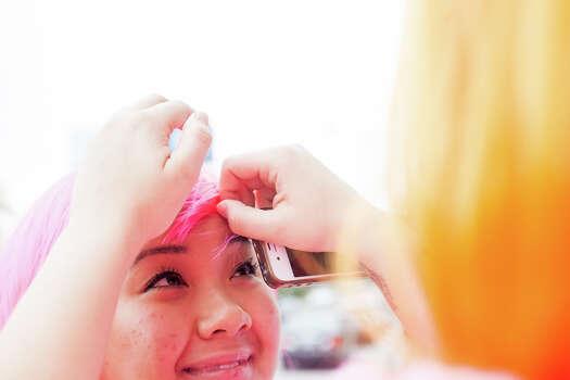 Judson High School senior Jade Tran smiles as one of her classmates adjusts her pink wig during Thursday's dress rehearsal. Photo: Julysa Sosa, For The San Antonio Express-News / Julysa Sosa For the San Antonio Express-News